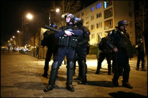 Police officers patrol a street of Villiers-le-Bel,